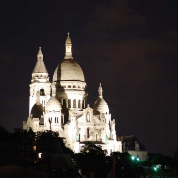 The basilica Sacré Coeur in Montmartre, Paris, paris is illuminated at night