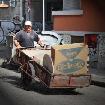 A man is looking for reusable furniture in waste containers in Sofia, Bulgaria