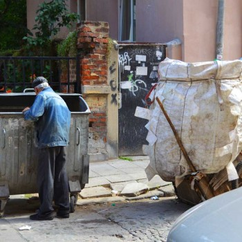 A man is looking for plastic bottles in Sofia, Bulgaria