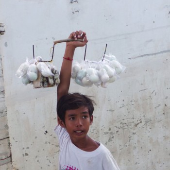 Let's leave our culinary comfort zones: A Boy is selling Balut on a ferry in Cambodia you are what you eat