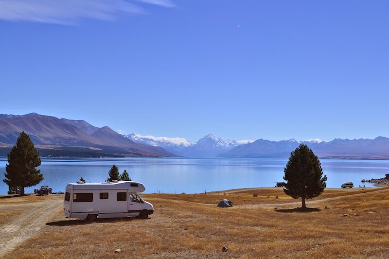 New Zealand camping grounds at a lake with mountain view