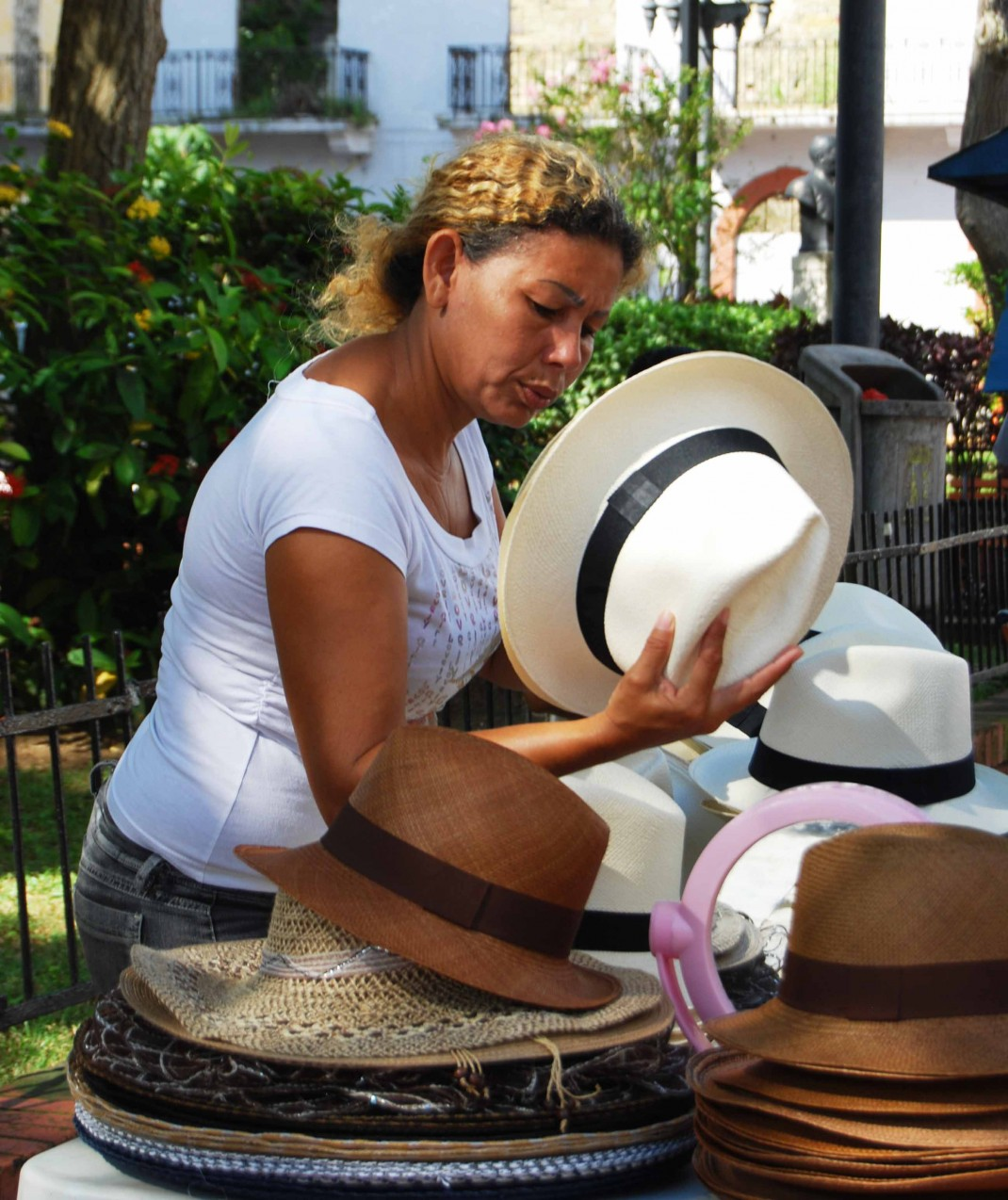 A woman selling Panama hats in the streets of Panama City