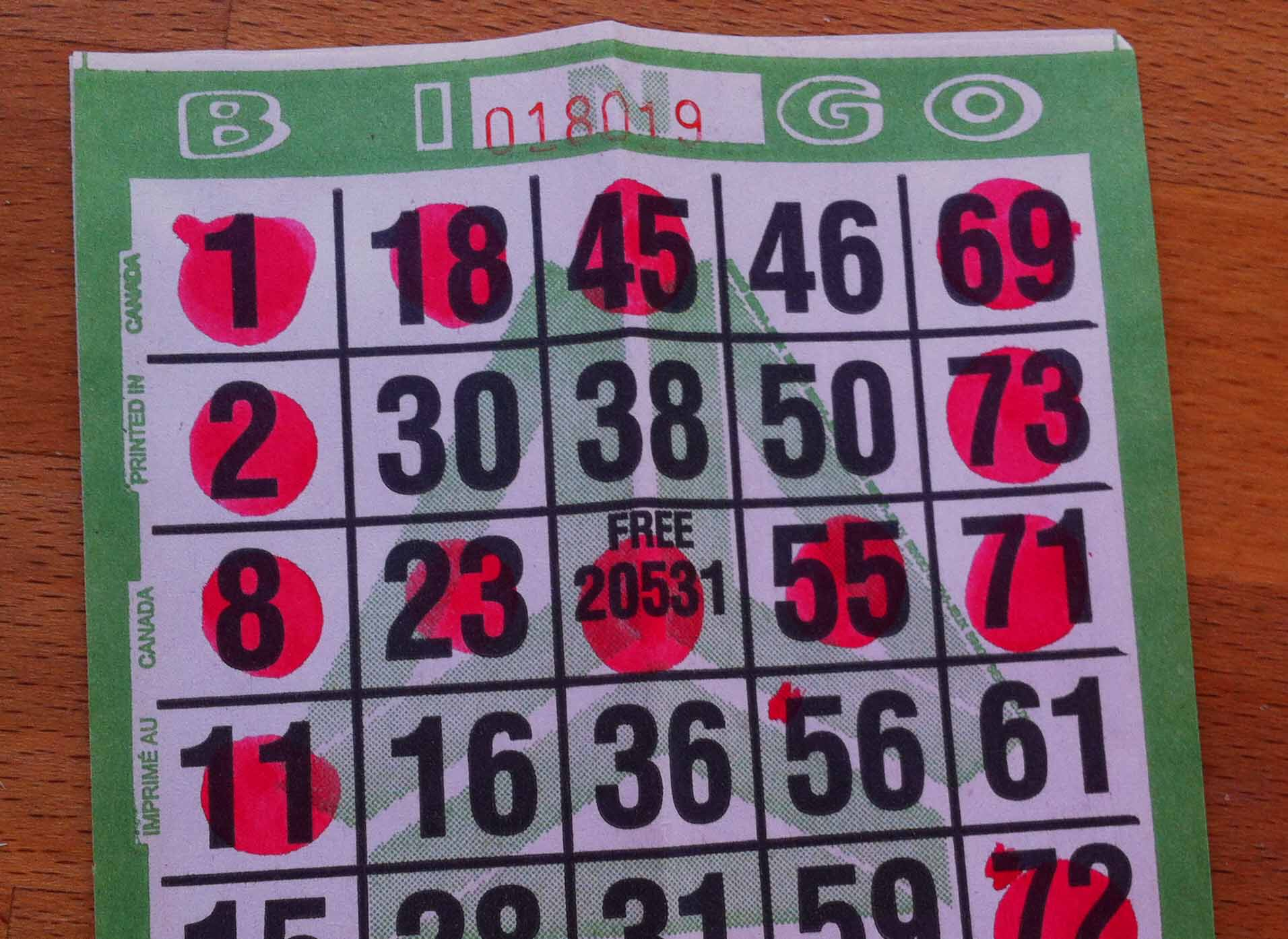 A Bingo ticket with a row of five, thanks to the joker in the middle of the ticket.